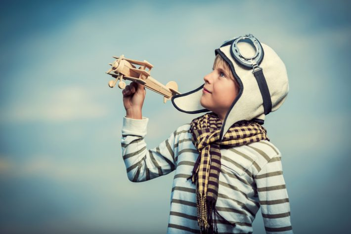 boy with toy plane