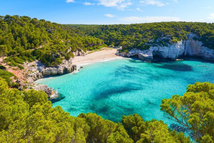 View of Mitjaneta beach with beautiful turquoise sea water, Meno