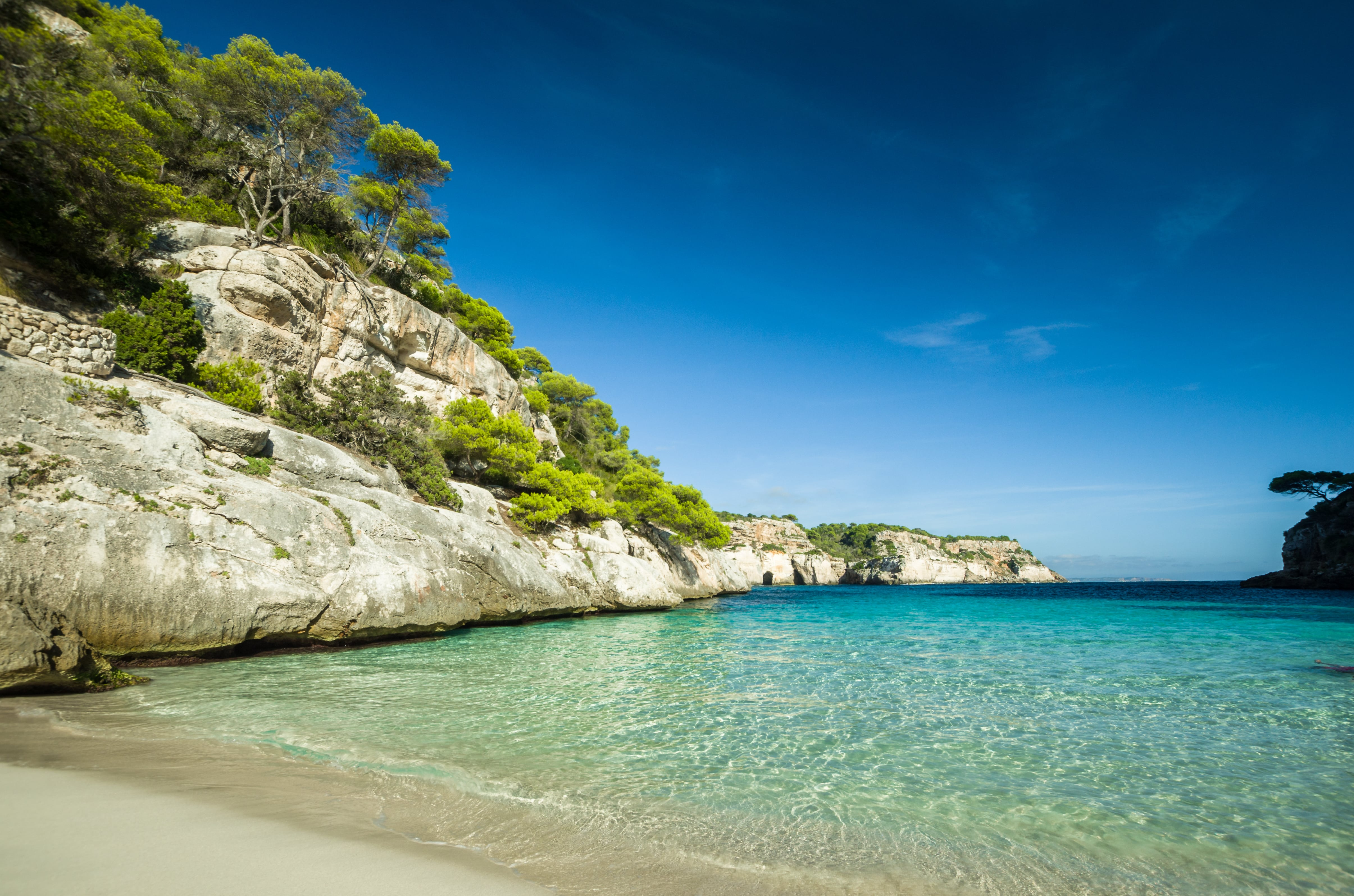 For calm turquoise waters and a charming ambience, head to Menorca's Cala Macarella